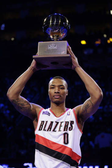 Damian Lillard of the Portland Trail Blazers raises the trophy after winning the skills challenge during NBA basketball All-Star Saturday Night, Feb. 16, 2013, in Houston. (AP Photo/Eric Gay)