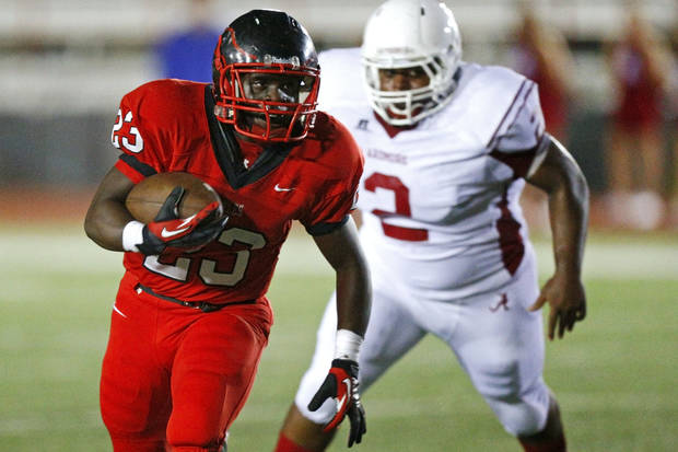 Del City's Anthony Mason runs past Ardmore's Darius Lawson during a high school football game in Del City, Okla., Friday, September 28, 2012. Photo by Bryan Terry, The Oklahoman
