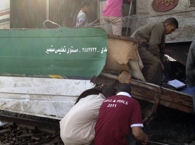 Egyptians inspect the wreckage after a speeding train crashed into a bus carrying children to their kindergarten in southern Egypt on Saturday, killing at least 47, officials said, near Assiut, in southern Egypt, Saturday, Nov. 17, 2012. The bus was carrying more than 50 children between 4 and 6 years old when it was hit near al-Mandara village in Manfaloot district in the province of Assiut, a security official said, adding that it appears that the railroad crossing was not closed as the train sped toward it. (AP Photo/Mamdouh Thabet)