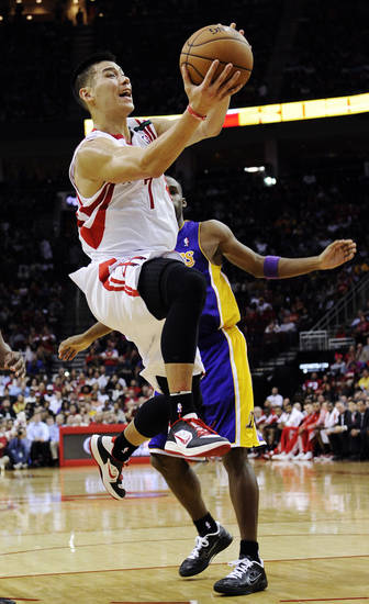 Houston Rockets' Jeremy Lin (7) goes to the basket in front of Los Angeles Lakers' Jodie Meeks in the second half of an NBA basketball game, Tuesday, Dec. 4, 2012, in Houston. (AP Photo/Pat Sullivan)