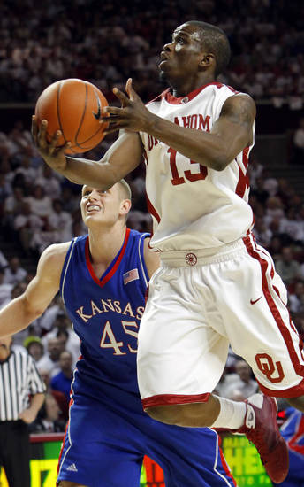 OU's Willie Warren (13) moves to the hoop in front of KU's Cole Aldrich (45) in the first half of the men's college basketball game between Kansas and Oklahoma at the Lloyd Noble Center in Norman, Okla., Monday, February 23, 2009. BY NATE BILLINGS, THE OKLAHOMAN