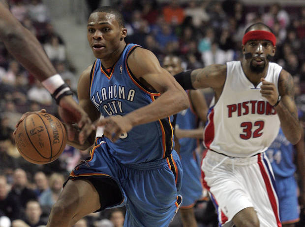 Oklahoma City Thunder&#039;s Russell Westbrook, left, dribbles past Detroit Pistons&#039; Richard Hamilton (32) during the first half of their NBA basketball game on Friday, Dec. 26, 2008, in Auburn Hills, Mich. (AP Photo/Jerry S. Mendoza) ORG XMIT: MIJM102
