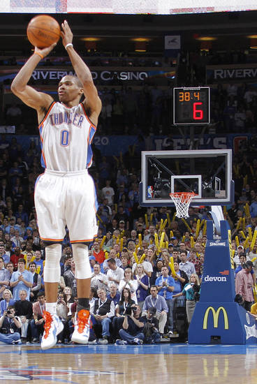 Oklahoma City Thunder point guard Russell Westbrook (0) shoots a three to seal the win over Phoenix during the NBA basketball game between the Oklahoma City Thunder and the Phoenix Suns at the Chesapeake Energy Arena on Wednesday, March 7, 2012 in Oklahoma City, Okla.  Photo by Chris Landsberger, The Oklahoman