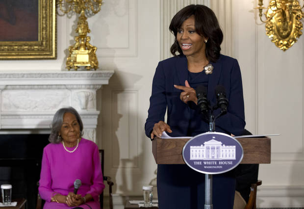 "First Lady Michelle Obama introduces a panel of the cast and crew of the movie ""42"", next to Rachel Robinson, widow of baseball great Jackie Robinson, before a workshop for high school and college students, Tuesday, April 2, 2013, in the State Dining Room of the White House in Washington.  (AP Photo/Jacquelyn Martin)"