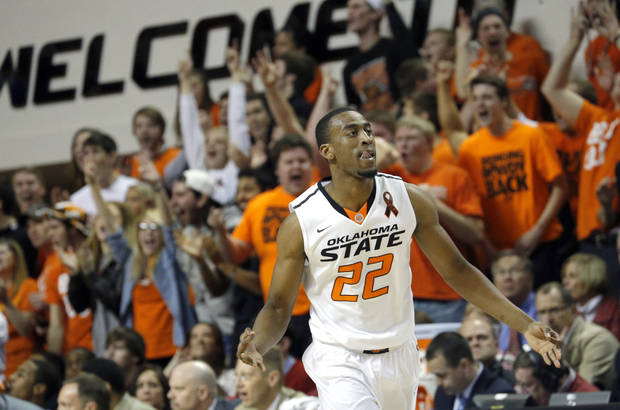 Oklahoma State's Markel Brown (22) celebrates a three-pointer during the Bedlam men's college basketball game between the Oklahoma State University Cowboys and the University of Oklahoma Sooners at Gallagher-Iba Arena in Stillwater, Okla., Saturday, Feb. 16, 2013. Photo by Sarah Phipps, The Oklahoman