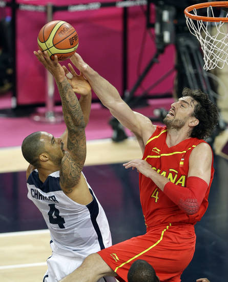 United States' Tyson Chandler puts up a shot against Spain's Pau Gasol during the men's gold medal basketball game at the 2012 Summer Olympics, Sunday, Aug. 12, 2012, in London. (AP Photo/Matt Slocum)
