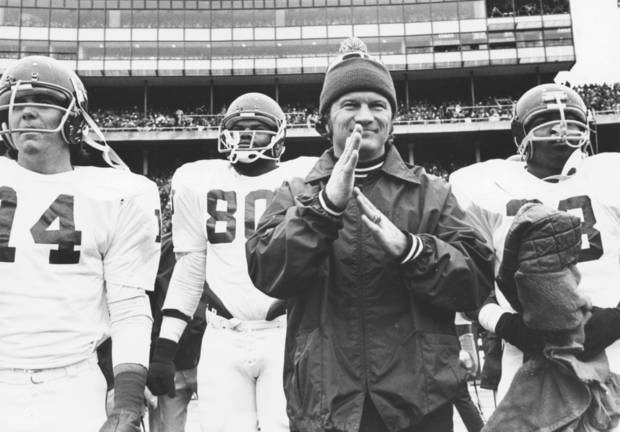 University of Oklahoma college football head coach Barry Switzer with players at the OU-Nebraska game in Lincoln in 1976. Staff photo ran in the 11-11-78 Daily Oklahoman.