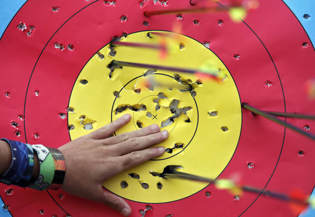 An athlete pulls arrows after shooting in the archery clinic during the opening day of activities for the Endeavor Games at the University of Central Oklahoma on Thursday, June 6, 2013 in Edmond, Okla. Photo by Chris Landsberger, The Oklahoman
