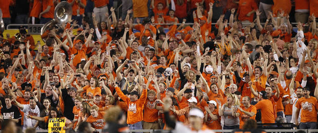 Oklahoma State fans react to a missed field goal by Stanford during overtime of the Fiesta Bowl NCAA college football game Monday, Jan. 2, 2012, in Glendale, Ariz. Oklahoma State won 41-38 in overtime. (AP Photo/Matt York)  ORG XMIT: PNP154