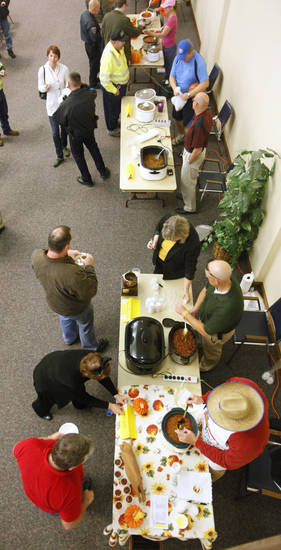 Edmond City employees line up for chili during the annual Edmond Employee Chili Cook-off in Edmond Thursday, Oct. 27, 2011. Photo by Paul B. Southerland, The Oklahoman