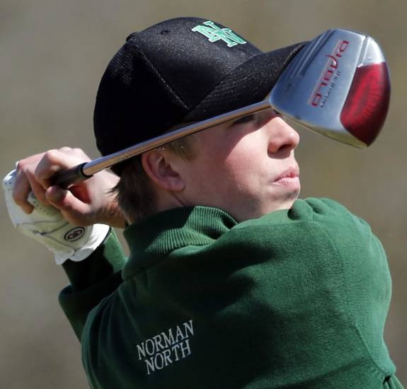 Norman North golfer Thomas Ludwig hits during the Norman North Invitational Golf Tournament at the Jimmie Austin Golf Club on Tuesday, March 26, 2013, in Norman, Okla.   Photo by Steve Sisney, The Oklahoman