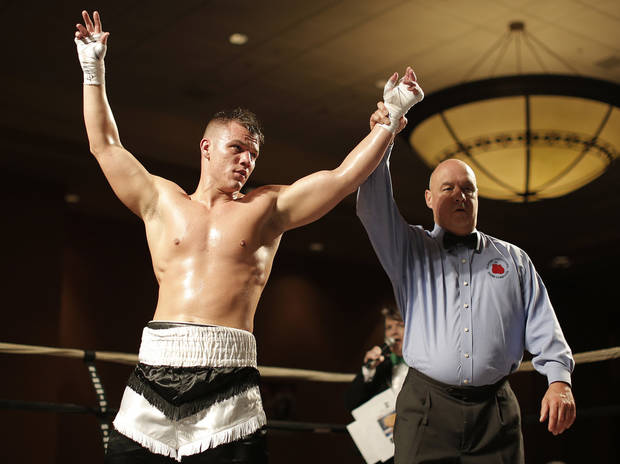 Bo Gibbs Jr., of Oklahoma City, wins a fight against Lyle Barron, of Oklahoma City, at the Cox Convention Center in Oklahoma City, Thursday, Sept. 20, 2012.  Photo by Garett Fisbeck, The Oklahoman