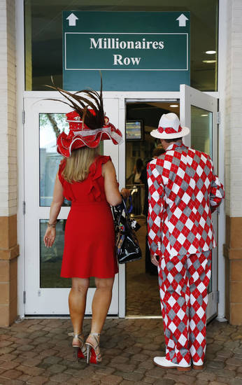 Spectators make their way to the grandstand viewing area before the 138th Kentucky Derby horse race at Churchill Downs, Saturday, May 5, 2012, in Louisville, Ky. (AP Photo/James Crisp) ORG XMIT: NY225