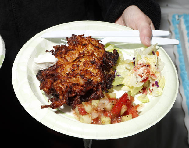 "A plate of latkas, the traditional potato pancakes served during Hanukkah, is shown at the OU Hillel Foundation's annual ""Latkas for Love"" fundraiser in Norman.  <strong>STEVE SISNEY - THE OKLAHOMAN</strong>"