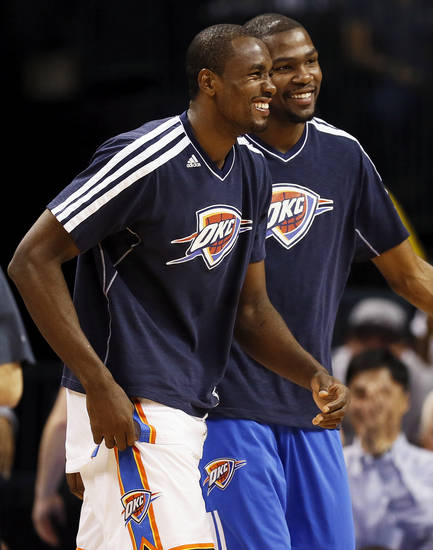 Oklahoma City starters Serge Ibaka (9), left, and Kevin Durant (35) smile in the bench area during the fourth quarter of an NBA basketball game between the Oklahoma City Thunder and Charlotte Bobcats at Chesapeake Energy Arena in Oklahoma City, Monday, Nov. 26, 2012. Oklahoma City won, 114-69. Photo by Nate Billings , The Oklahoman