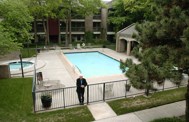 OKLAHOMA CITY, OK, FRIDAY, 5/13/2005, SYCAMORE SQUARE RE-VISITED;    Ed Fretwell stands just inside the pool area in the private interior courtyard area at Sycamore Square in downtown Oklahoma City.  Photo by Roger Klock