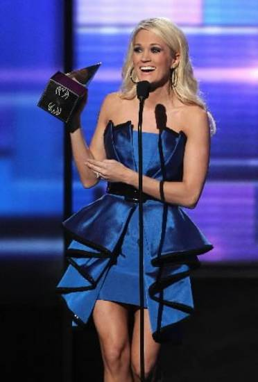 "Carrie Underwood accepts the award for favorite album - country for ""Blown Away"" at the 40th Anniversary American Music Awards on Sunday, Nov. 18, 2012, in Los Angeles. (AP)"