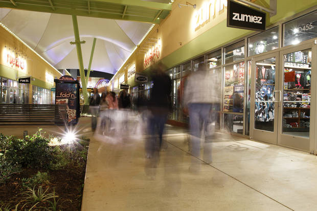 Customers walk through The Outlet Shoppes at Oklahoma City during Black Friday in November. Oklahoman Archives Photo