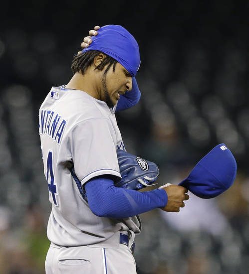 Kansas City Royals starting pitcher Ervin Santana pauses after giving up a hit to the Seattle Mariners in the second inning of a baseball game Wednesday, Sept. 25, 2013, in Seattle. (AP Photo/Elaine Thompson)