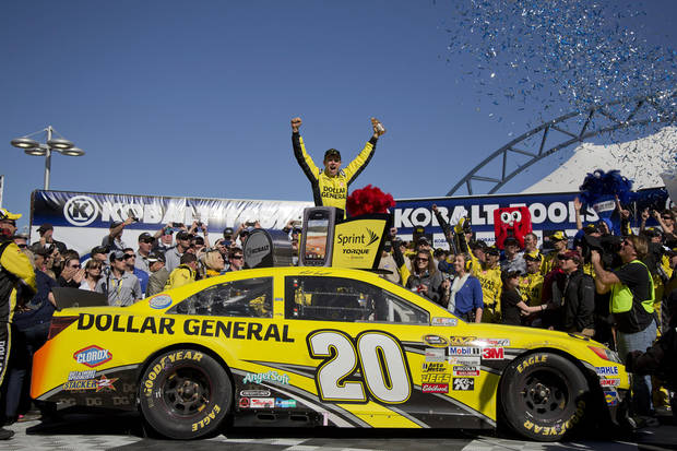 Driver Matt Kenseth celebrates in Victory Lane after winning the NASCAR Sprint Cup Series auto race, Sunday, March 10, 2013 in Las Vegas. (AP Photo/Julie Jacobson)