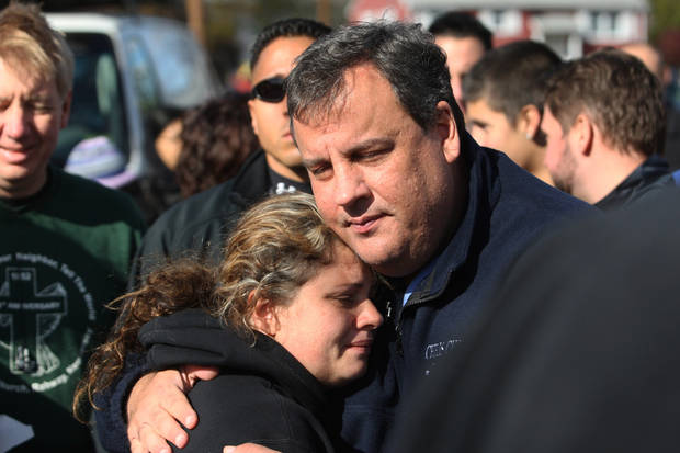 New Jersey Gov. Chris Christie comforts Kerri Berean, 33, a Chapman Street resident, Saturday, Nov. 3, 2012, in Little Ferry, N.J. Christie toured a section of Little Ferry that was flooded when Superstorm Sandy caused a tidal surge on the Hackensack River that overtook a natural berm protecting the town. (AP Photo/The Star-Ledger, David Gard, Pool) ORG XMIT: NJNEW110