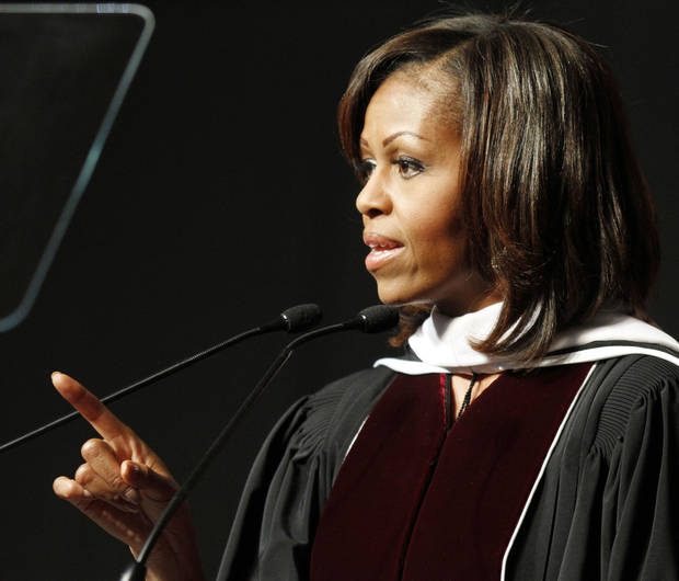 First lady Michelle Obama addresses graduates during commencement exercises at Eastern Kentucky University in Richmond, Ky., Saturday, May 11, 2013. (AP Photo/James Crisp)