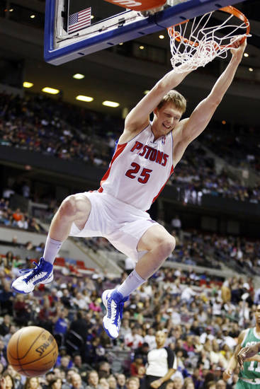 Detroit Pistons forward Kyle Singler (25) dunks against the Boston Celtics in the first half of an NBA basketball game, Sunday, Jan. 20, 2013, in Auburn Hills, Mich. (AP Photo/Duane Burleson)