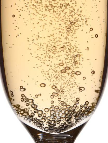 To toast properly, use a tall, slim flute, so you can watch the bubbles rise. Thinkstock photo