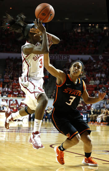 Oklahoma's Aaryn Ellenberg (3) shoots as Oklahoma State's Tiffany Bias (3) defends during the women's Bedlam basketball game between Oklahoma State University and Oklahoma at the Lloyd Noble Center in Norman, Okla., Sunday, Feb. 10, 2013.Photo by Sarah Phipps, The Oklahoman