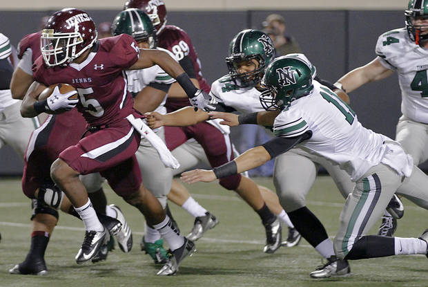 Jenks' Trey'Vonne Barr'e (5) breaks through the Norman North defense of Lavonte Doxey (84) and D.J. Gasso (11) during the Class 6A Oklahoma state championship football game between Norman North High School and Jenks High School at Boone Pickens Stadium on Friday, Nov. 30, 2012, in Stillwater, Okla.   Photo by Chris Landsberger, The Oklahoman