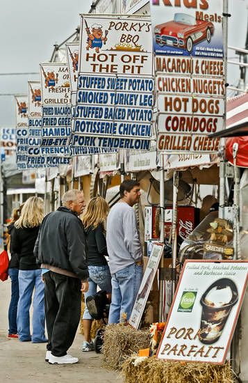 Fair visitors line up for the selection of foods for lunch at the Oklahoma State Fair at State Fair Park on Friday, Sept. 14, 2012, in Oklahoma City, Oklahoma.  Photo by Chris Landsberger, The Oklahoman