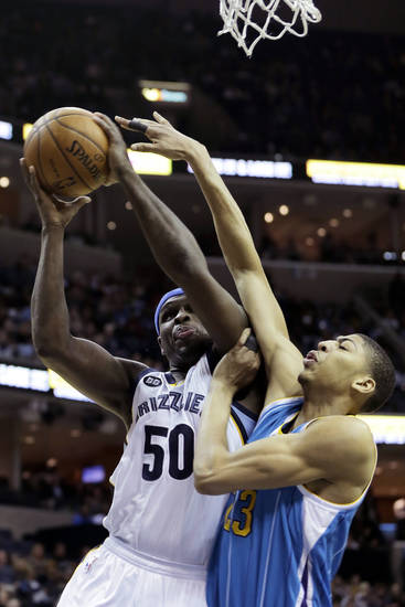 Memphis Grizzlies' Zach Randolph (50) goes to the basket as New Orleans Hornets' Anthony Davis, right, tries to block the shot during the first half of an NBA basketball game in Memphis, Tenn., Sunday, Jan. 27, 2013. (AP Photo/Danny Johnston)