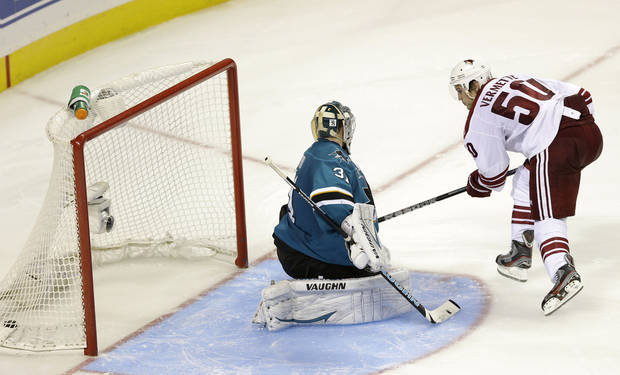 Phoenix Coyotes' Antoine Vermette (50) scores the game-winning goal past San Jose Sharks goalie Antti Niemi, of Finland, during the shootout in an NHL hockey game on Saturday, Nov. 2, 2013, in San Jose, Calif. Phoenix won 3-2. (AP Photo/Marcio Jose Sanchez)