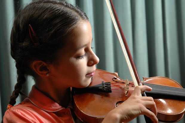 OKC's Montserat Ruffin practices the violin.  Violin training is offered this summer at OCU's Strings Camp.<br/><b>Community Photo By:</b> Jerry Heimer<br/><b>Submitted By:</b> Dan,