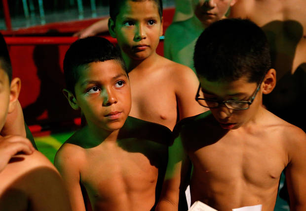 Chris Barba, 9, of Edmond, waits in line to weigh in before his first fight at The Underground Arena in Oklahoma City, Saturday, June 15, 2013. Photo by Bryan Terry, The Oklahoman