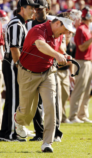 Head coach Bob Stoops reacts to a play review reversing a call on the field and giving the Sooners the ball after a fumble by TCU during the second half of the college football game where the University of Oklahoma Sooners (OU) defeated the Texas Christian University Horned Frogs (TCU) 24-17 at Amon G. Carter Stadium in Fort Worth, Texas, on Saturday, Dec. 1, 2012. Photo by Steve Sisney, The Oklahoman