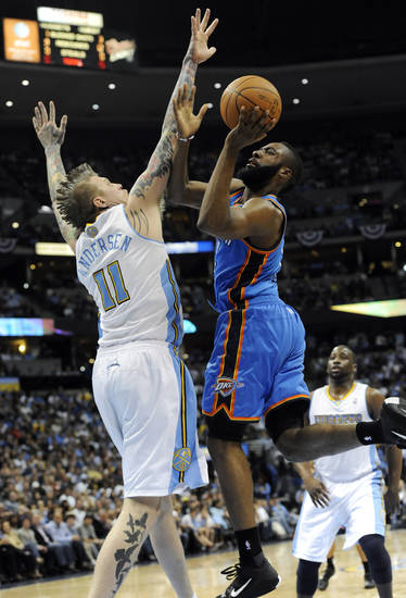 Oklahoma City Thunder guard James Harden (13) goes up for a shot against Denver Nuggets center Chris Andersen (11) during the first half of game 3 of a first-round NBA basketball playoff series Saturday, April 23, 2011, in Denver. (AP Photo/Jack Dempsey)