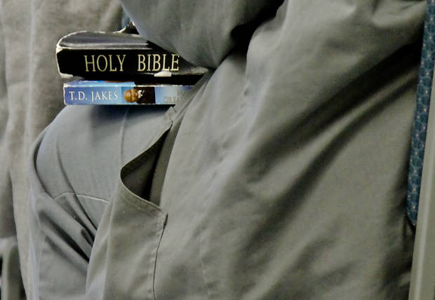 An inmates sits with her Bible and other faith materials during a Bible study at Mabel Bassett Correctional Center in McLoud. <strong>CHRIS LANDSBERGER - CHRIS LANDSBERGER</strong>