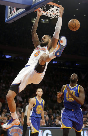 New York Knicks' Tyson Chandler (6) dunks the ball during the first half of an NBA basketball game against the Golden State Warriors, Wednesday, Feb. 27, 2013, in New York. (AP Photo/Frank Franklin II)