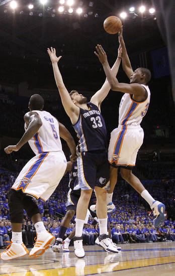 Oklahoma City's Kevin Durant (35) shoots the ball over Marc Gasol (33) of Memphis during game two of the Western Conference semifinals between the Memphis Grizzlies and the Oklahoma City Thunder in the NBA basketball playoffs at Oklahoma City Arena in Oklahoma City, Tuesday, May 3, 2011. Photo by Chris Landsberger, The Oklahoman