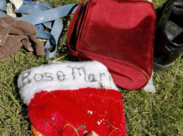 A Christmas stocking for Rose Marie Juul lies among other personal items in the front yard of her grandparent's home near Fargo after a  killer tornado roared through sections of Woodward last weekend.   Rose Marie, 10, died as she and her father were trying to make it to a storm cellar when the twister hit. Tuesday, April 17, 2012.   Photo by Jim Beckel, The Oklahoman