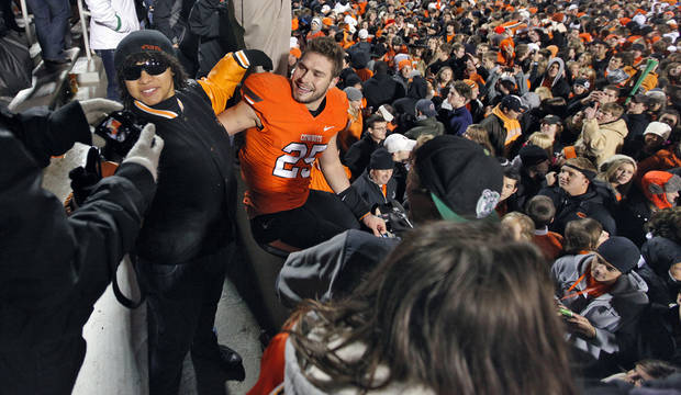 Oklahoma State's Josh Cooper (25) celebrates with fans after the 44-10 win over Oklahoma during the 2011 Bedlam game in Stillwater, Okla. Photo by Chris Landsberger, The Oklahoman