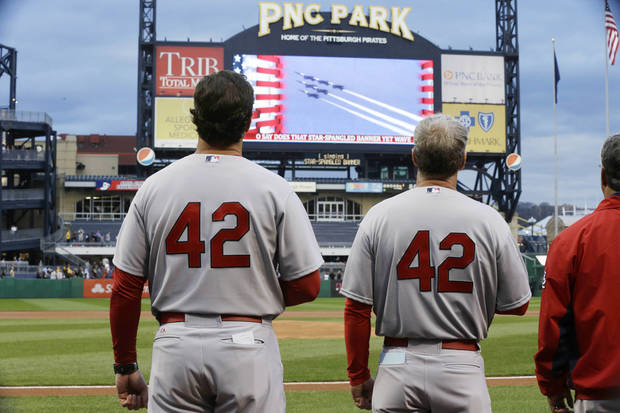 St. Louis Cardinals manager Mike Metheny, left, and his team line up for the national anthem wearing No. 42 in honor of Jackie Robinson before a baseball game against the Pittsburgh Pirates in  Pittsburgh Monday, April 15, 2013. (AP Photo/Gene J. Puskar)