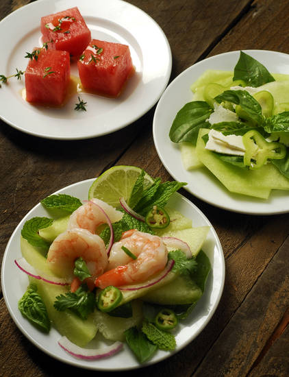 Melons are a staple of summer, but you can add a bit of heat with some spice to compliment the cool melon. At top is cured watermelon crudo with thyme, Vietnamese shrimp with green melon is bottom and at right is green melon with cubanelle peppers and ricotta. <strong>MARK DuFRENE - MCT</strong>