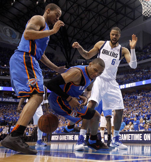 Oklahoma City's Russell Westbrook (0) goes for the ball between Eric Maynor (6) and Tyson Chandler (6) of Dallas during game 5 of the Western Conference Finals in the NBA basketball playoffs between the Dallas Mavericks and the Oklahoma City Thunder at American Airlines Center in Dallas, Wednesday, May 25, 2011. Photo by Bryan Terry, The Oklahoman
