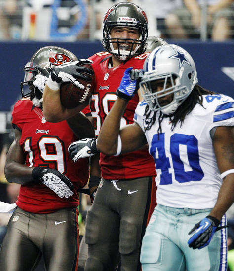Tampa Bay Buccaneers tight end Luke Stocker (88) and Mike Williams (19) celebrate a touchdown as Dallas Cowboys defensive back Danny McCray (40) walks away during the first half of an NFL football game, Sunday, Sept. 23, 2012, in Arlington, Texas. (AP Photo/Tony Gutierrez)