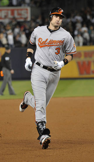 Baltimore Orioles' Ryan Flaherty runs the bases after hitting a home run during the third inning of Game 3 of the Orioles' American League division baseball series against the New York Yankees, Wednesday, Oct. 10, 2012, in New York. (AP Photo/Bill Kostroun)