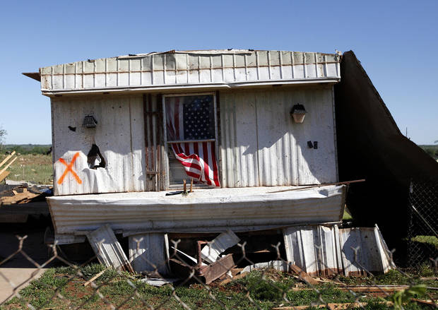 A damaged mobile home at the is pictured at the Hideaway mobile home park, Sunday, April, 15, 2012. A tornado struck Woodward early Sunday morning. Photo by Sarah Phipps, The Oklahoman.
