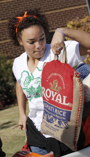 Hattie Msuya helps load food collected for the Regional Food Bank of Oklahoma at Bishop McGuinness High School Friday, November 9, 2012.  The school collected 75,660 pounds of food. Photo by Doug Hoke, The Oklahoman
