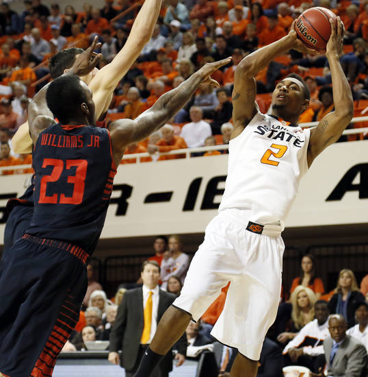 Oklahoma State's Le'Bryan Nash (2) shoots against Texas Tech's Jamal Williams Jr. (23) and Dejan Kravic (11) during a men's college basketball game between Oklahoma State University and Texas Tech at Gallagher-Iba Arena in Stillwater, Okla., Saturday, Jan. 19, 2013. OSU won, 79-45. Photo by Nate Billings, The Oklahoman